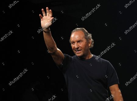 Spanish designer Custo Dalmau greets at the end of his fashion show during the 72th Mercedes-Benz Fashion Madrid, in Madrid, central Spain, 12 September 2020. The MBFWMadrid runs from 10 to 13 September 2020 under security measures due to the ongoing pandemic of the COVID-19 disease caused by the SARS-CoV-2 coronavirus.