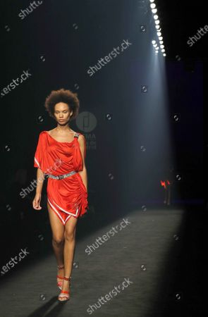 Stock Image of Models wear a creation by Custo Barcelona brand during the 72th Mercedes-Benz Fashion Madrid, in Madrid, central Spain, 12 September 2020. The MBFWMadrid runs from 10 to 13 September 2020 under security measures due to the ongoing pandemic of the COVID-19 disease caused by the SARS-CoV-2 coronavirus.