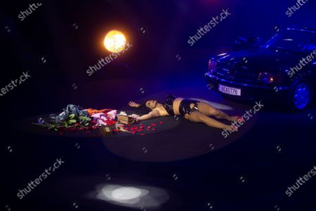 Performance artist lies down on the catwalk at the end of a fashion show by Brain and Beast during the Mercedes-Benz Fashion Week in Madrid, Spain