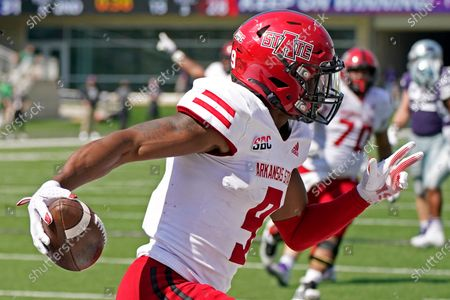 Arkansas State wide receiver Jonathan Adams Jr. celebrates after scoring the winning touchdown during the second half of an NCAA college football game against Kansas State, in Manhattan, Kan
