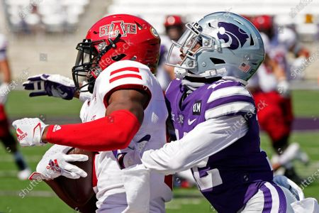 Arkansas State wide receiver Jonathan Adams Jr., left, catches a pass under pressure from Kansas State defensive back AJ Parker (12) to score the winning touchdown during the second half of an NCAA college football game, in Manhattan, Kan