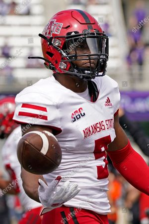 Arkansas State wide receiver Jonathan Adams Jr. celebrates after scoring a touchdown during the second half of an NCAA college football game against Kansas State, in Manhattan, Kan