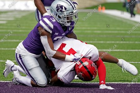Arkansas State wide receiver Jonathan Adams Jr. (9) downed in the end zone by Kansas State defensive back Kiondre Thomas (3) after scoring a touchdown during the second half of an NCAA college football game, in Manhattan, Kan