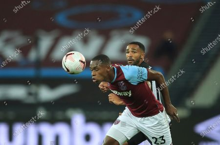 West Ham's Issa Diop heads the ball in front of Newcastle's Callum Wilson during the English Premier League soccer match between West Ham United and Newcastle United at the London Stadium in London