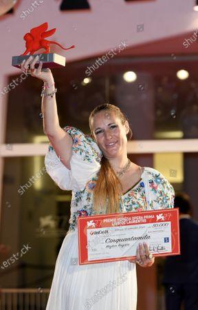 "Director Ana Rocha de Sousa poses with the Lion of the Future - ""Luigi De Laurentiis"" Venice Award for a Debut Film"
