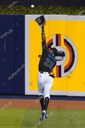 Miami Marlins right fielder Lewis Brinson catches a ball hit by Philadelphia Phillies' Andrew McCutchen during the eighth inning of a baseball game, in Miami
