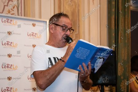 """Stock Picture of The actor Massimo Lopez presents his book """"Stai Attento alle Nuvole"""" written by Sante Roperto in Caserta."""