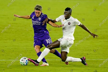 Orlando City midfielder Mauricio Pereyra, left, and Inter Miami's Blaise Matuidi, right, battle for the ball during the first half of an MLS soccer match, in Orlando, Fla