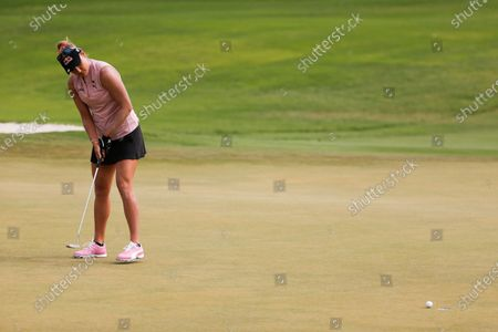 Lexi Thompson watches her shot on the first hole during the third round of the LPGA's ANA Inspiration golf tournament at Mission Hills Country Club in Rancho Mirage, Calif