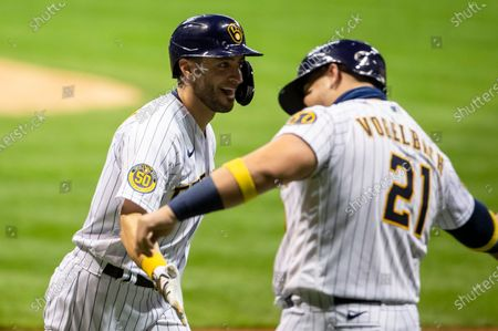 Stock Picture of Milwaukee Brewers left fielder Ryan Braun #8 is met at home plate by Milwaukee Brewers Daniel Vogelbach #21 after hitting a two run homer in the 4th inning of the Major League Baseball game between the Milwaukee Brewers and the Chicago Cubs at Miller Park in Milwaukee, WI
