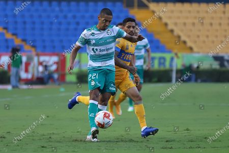 Tigres' Javier Aquino (R) vies for the ball with Jair Gonzalez (L) of Santos during a Mexican soccer 2020 Guardianes tournament match at the Universitario stadium in Monterrey, Mexico, 12 September 2020.