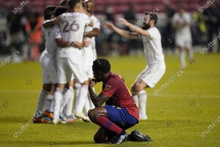 Colorado Rapids midfielder Cole Bassett (26) celebrates his second-half goal with teammates as Real Salt Lake defender Nedum Onuoha, foreground, reacts during an MLS soccer match, in Sandy, Utah