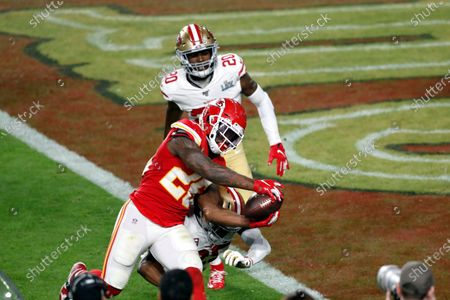 Kansas City Chiefs running back Damien Williams (26) is hit by San Francisco 49ers cornerback Richard Sherman (25) before scoring a touchdown during the NFL Super Bowl 54 football game between the San Francisco 49ers and Kansas City Chiefs, in Miami Gardens, Fla. The Kansas City Chiefs won 31-20