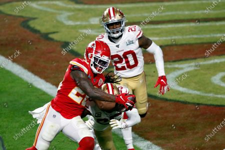 Kansas City Chiefs running back Damien Williams (26) is hit by San Francisco 49ers cornerback Richard Sherman (25) during the NFL Super Bowl 54 football game between the San Francisco 49ers and Kansas City Chiefs, in Miami Gardens, Fla. The Kansas City Chiefs won 31-20