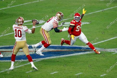Stock Picture of San Francisco 49ers quarterback Jimmy Garoppolo (10) passes the ball in front Kansas City Chiefs outside linebacker Terrell Suggs (94) during the NFL Super Bowl 54 football game between the San Francisco 49ers and Kansas City Chiefs, in Miami Gardens, Fla. The Kansas City Chiefs won 31-20