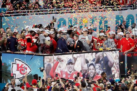Fox Sports analyst Terry Bradshaw interviews Kansas City Chiefs Chairman and CEO Clark Hunt with the Lombardi Trophy after during the NFL Super Bowl 54 football game between the San Francisco 49ers and Kansas City Chiefs, in Miami Gardens, Fla. The Kansas City Chiefs won 31-20