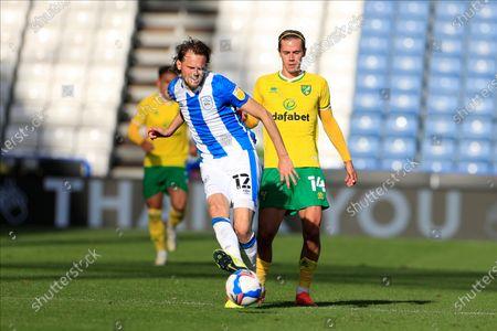Richard Stearman (12) of Huddersfield Town passes the ball
