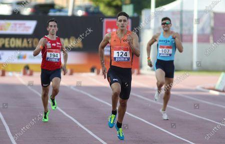 Stock Image of Manuel Bea Medina, Julio Arenas Robles and Javier Sanchez Santos compete in semifinals of 800 meters during the 100th Spanish Athletics Championship at Juan de la Cierva Municipal Sports Center on September 12, 2020 in Getafe, Madrid, Spain.
