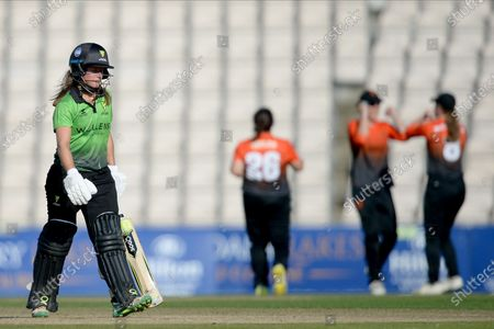 Sophie Luff of Western Storm walks off after being dismissed by Charlotte Taylor