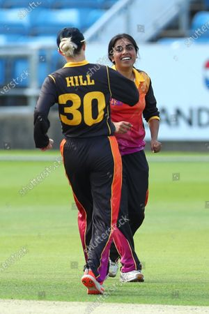 Anisha Patel and Chloe Hill of Central Sparks celebrate a wicket.