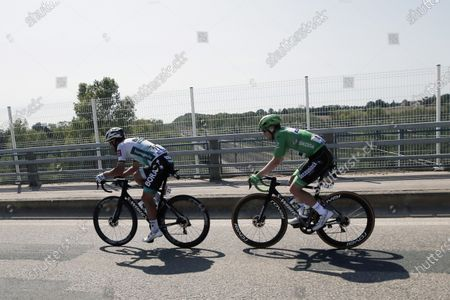 Slovakia's Peter Sagan, left, and Ireland's Sam Bennett, wearing the best sprinters green jersey, ride during the stage 15 of the Tour de France cycling race over 174 kilometers (108 miles), with start in Lyon and finish in Grand Colombier