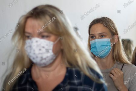 Stock Picture of Israeli top model Bar Refaeli (R) wears a face mask amid the coronavirus pandemic as she leaves with her mother Tzipora 'Tzipi' Levine (L) a court room in Tel Aviv, Israel, 13 September 2020. An Israeli court has sentenced top model Bar Refaeli to nine months of community service and her mother was sentenced to 16 months in prison, ending a prolonged tax evasion case.