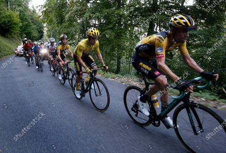 Slovenian rider Primoz Roglic (2-R) of Team Jumbo-Visma wearing the overall leader's yellow jersey and his Dutch teammate Tom Dumoulin (R) in action during the 15th stage of the 107th edition of the Tour de France cycling race over 174.5km from Lyon to Le Grand Colombier, France, 13 September 2020.