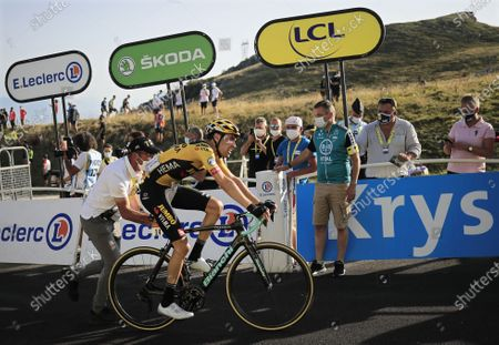 Dutch rider Tom Dumoulin (C) of Team Jumbo-Visma reacts after crossing the finish line of the 15th stage of the Tour de France over 174.5km from Lyon to Grand Colombier, France, 13 September 2020.
