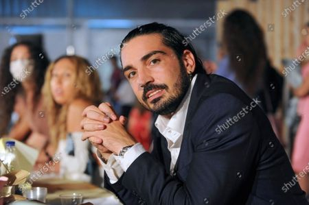 """Twenty-year-old Gennaro Napolitano from Acerra is a model who has walked the catwalk of prestigious national and European fashion contests, as well as an aspiring actor enrolled in Raffaele La Rocca's FCS Management Academy of Acting. Protagonist in the film """"I figli della Mala"""" based on the homonymous book by Carmela Pascarella, and featured in a television series """"Bastard Karma"""" that is becoming popular all over the world."""