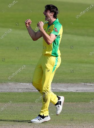 Australia's Pat Cummins celebrates the dismissal of England's Jos Buttler during the second ODI cricket match between England and Australia, at Old Trafford in Manchester, England