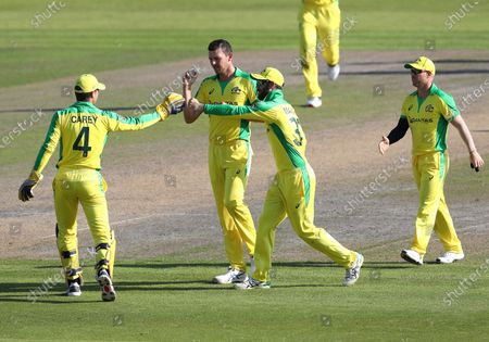 Australia's Josh Hazlewood, second left, celebrates the dismissal of England's Chris Woakes during the second ODI cricket match between England and Australia, at Old Trafford in Manchester, England
