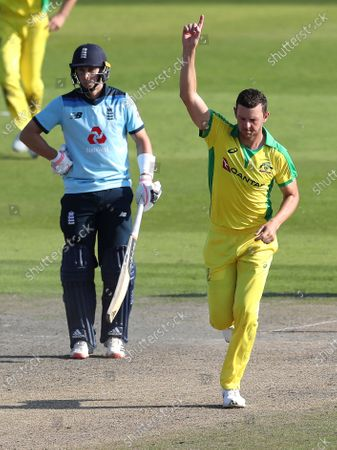 Australia's Josh Hazlewood, right, celebrates the dismissal of England's Chris Woakes during the second ODI cricket match between England and Australia, at Old Trafford in Manchester, England