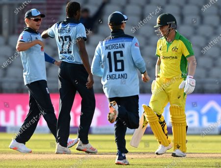 Australia's David Warner, right, walks off the field after being dismissed by England's Jofra Archer, left, during the second ODI cricket match between England and Australia, at Old Trafford in Manchester, England