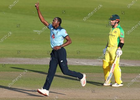 England's Jofra Archer celebrates the dismissal of Australia's David Warner during the second ODI cricket match between England and Australia, at Old Trafford in Manchester, England