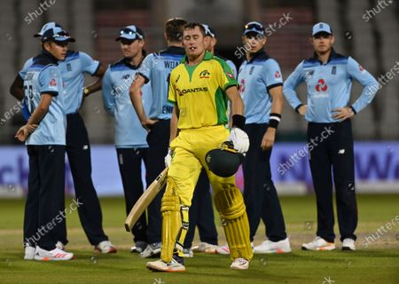 Australia's Marnus Labuschagne, front, walks off the field after being dismissed by England's Chris Woakes during the second ODI cricket match between England and Australia, at Old Trafford in Manchester, England