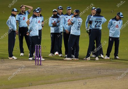 England's Chris Woakes, second left, and teammates wait for the third umpires decision for the wicket of Australia's Marnus Labuschagne during the second ODI cricket match between England and Australia, at Old Trafford in Manchester, England