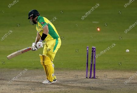 Australia's captain Aaron Finch is bowled out by England's Chris Woakes during the second ODI cricket match between England and Australia, at Old Trafford in Manchester, England