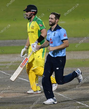 England's Chris Woakes, right, celebrates the dismissal of Australia's captain Aaron Finch, left, during the second ODI cricket match between England and Australia, at Old Trafford in Manchester, England