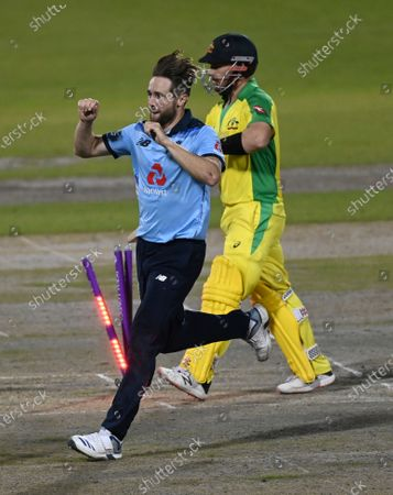 England's Chris Woakes, left, celebrates the dismissal of Australia's captain Aaron Finch, right, during the second ODI cricket match between England and Australia, at Old Trafford in Manchester, England