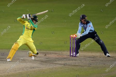 Australia's Alex Carey, left, is stumped by England's wicketkeeper Jos Buttler, right, during the second ODI cricket match between England and Australia, at Old Trafford in Manchester, England