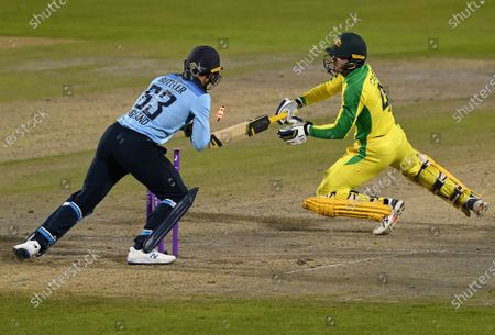 Australia's Alex Carey, right, is stumped by England's wicketkeeper Jos Buttler, left, during the second ODI cricket match between England and Australia, at Old Trafford in Manchester, England