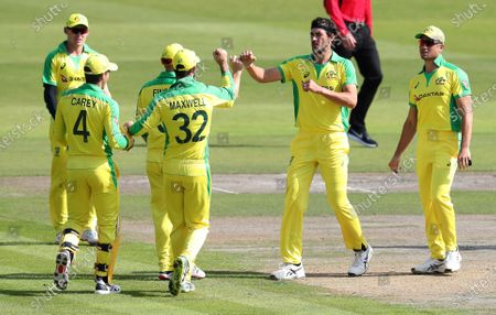 Australia's Mitchell Starc, second right, celebrates with teammates the dismissal of England's Jonny Bairstow during the second ODI cricket match between England and Australia, at Old Trafford in Manchester, England