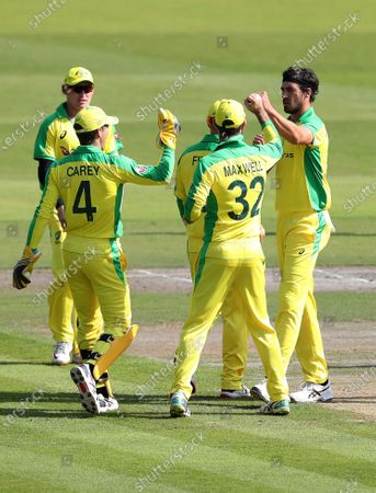 Stock Image of Australia's Mitchell Starc, right, celebrates with teammates the dismissal of England's Jonny Bairstow during the second ODI cricket match between England and Australia, at Old Trafford in Manchester, England