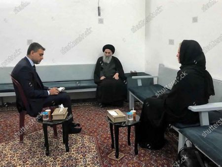 Stock Photo of This handout photo from the office of Grand Ayatollah Ali al-Sistani shows Iraq's top Shiite cleric Grand Ayatollah Ali al-Sistani, center, meeting with U.N. envoy to Iraq Jeanine Hennis-Plasschaert, right, in Najaf, Iraq, . In a statement released by his office after meeting the U.N. envoy Al-Sistani threw his support behind the prime minister's announcement to hold parliamentary elections ahead of schedule next year, a key demand of protesters