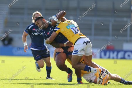 Bath's Jonathan Joseph tackles Sale Sharks Manu Tuilagi  during the Gallagher Premiership Rugby match between Sale Sharks and Bath Rugby at the AJ Bell Stadium, Eccles