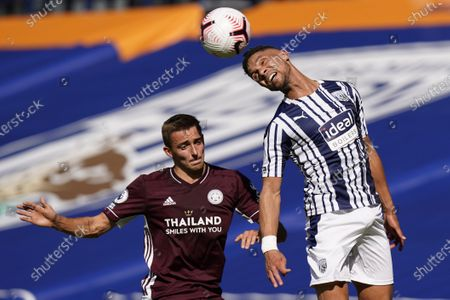 Leicester's Timothy Castagne, left, and West Bromwich Albion's Kieran Gibbs vie for the ball during the English Premier League soccer match between West Bromwich and Leicester City at the Hawthorns in West Bromwich, England, Sunday, Sept.13, 2020
