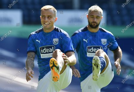 Kamil Grosicki (L) abd Charlie Austin (R) of West Bromwich warm up ahead of the English Premier League soccer match between West Bromwich Albion and Leicester City in West Bromwich, Britain, 13 September 2020.