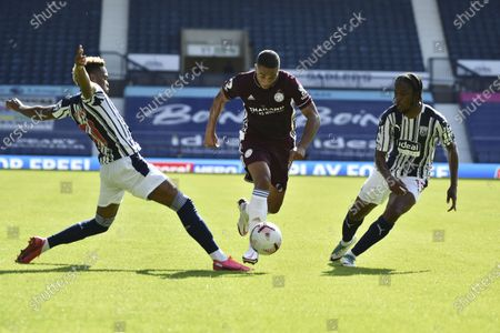 Leicester's Youri Tielemans, center, dribbles past West Bromwich Albion's Grady Diangana, left, and West Bromwich Albion's Kieran Gibbs during the English Premier League soccer match between West Bromwich and Leicester City at the Hawthorns in West Bromwich, England, Sunday, Sept.13, 2020