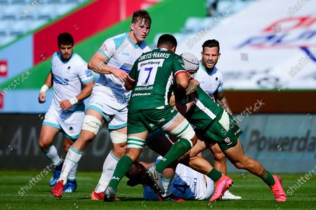 Niall Annett of Worcester Warriors is challenged by Isaac Curtis-Harris of London Irish and Terrence Hepetema of London Irish
