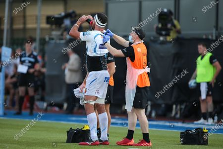 Tom Price of Exeter Chiefs receives treatment